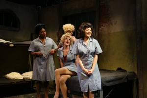 Mary Anderson (Right, Played by Elizabeth Morgan), Trixie (Left, played by Steve Love), Earl Jean (Far Left, Played by Robert Williams), and Big Lorraine (Obscured, played by Sydney Genco)